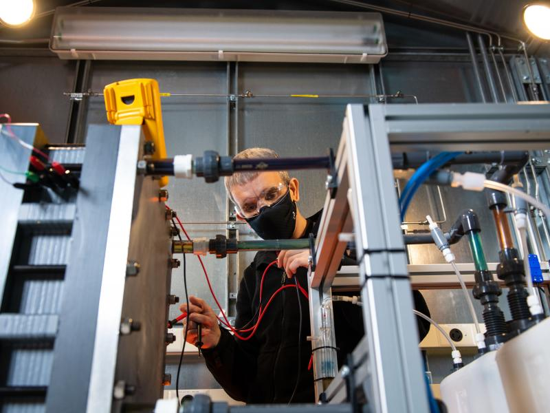 Picture of a scientist working on a flow battery design in one of PNNL's prototyping labs.