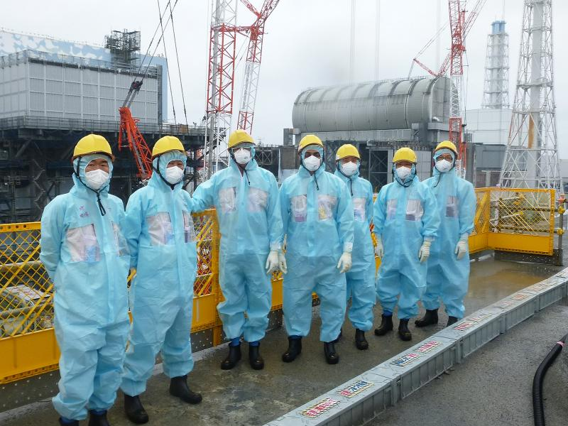 Group of visitors in front of Daiichi Nuclear Reactor in Fukushima Japan